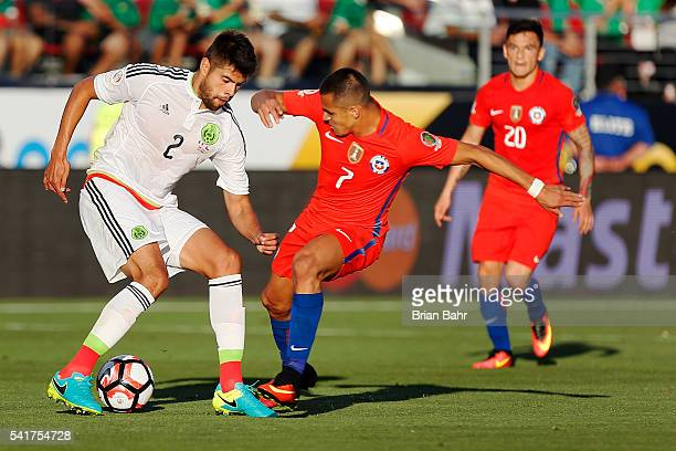 Alexis Sanchez of Chile gets stopped by Nestor Araujo of Mexico in the first half of a Quarterfinal match at Levi's Stadium as part of Copa America...