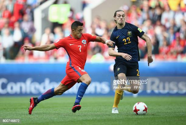Alexis Sanchez of Chile is closed down by Jackson Irvine of Australia during the FIFA Confederations Cup Russia 2017 Group B match between Chile and...