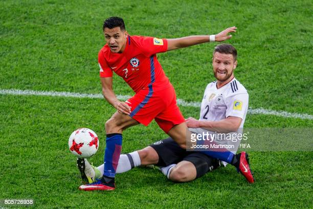 Alexis Sanchez of Chile is tackled by Shkodran Mustafi of Germany during FIFA Confederations Cup Russia final match between Chile and Germany at...