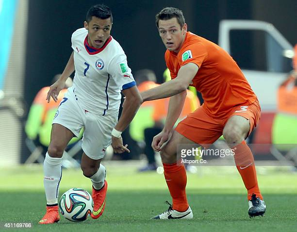 Alexis Sanchez of Chile is tackled by Stefan De Vrij of the Netherlands during the 2014 FIFA World Cup Brazil Group B match between the Netherlands...