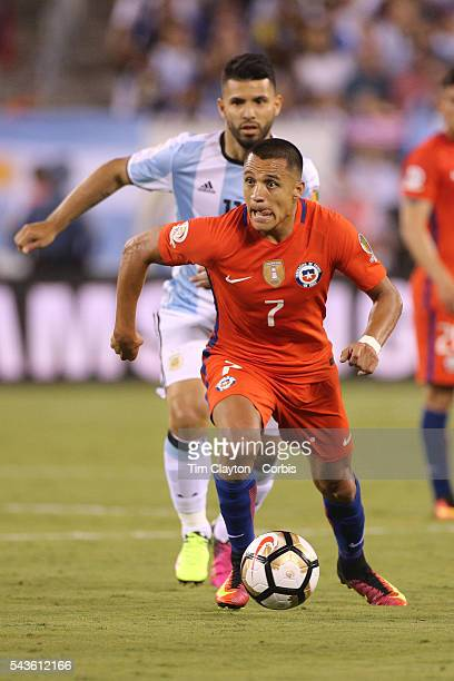 Alexis Sanchez of Chile on the ball watched by Sergio Aguero of Argentina during the Argentina Vs Chile Final match of the Copa America Centenario...