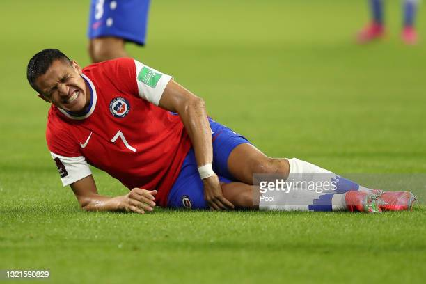 Alexis Sanchez of Chile reacts after a foul during a match between Argentina and Chile as part of South American Qualifiers for Qatar 2022 at Estadio...