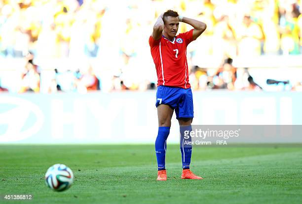 Alexis Sanchez of Chile reacts after his penalty kick being saved in a penalty shootout during the 2014 FIFA World Cup Brazil Round of 16 match...
