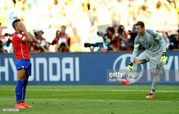 Alexis Sanchez of Chile reacts after his penalty kick saved by Julio Cesar of Brazil in a penaly shootout during the 2014 FIFA World Cup Brazil Round...