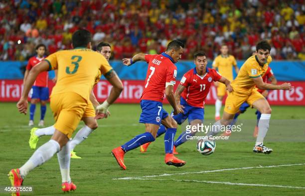 Alexis Sanchez of Chile shoots and scores his team's first goal during the 2014 FIFA World Cup Brazil Group B match between Chile and Australia at...