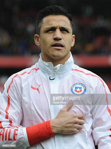 Alexis Sanchez of Chile sings the national anthem before the International Friendly match between Brazil and Chile at Emirates Stadium on March 29...