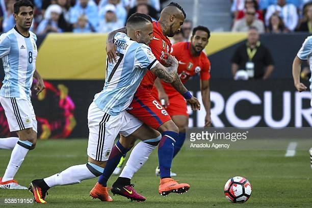 Alexis Sanchez of chile struggle for the ball against Nicolas Otamendi of Argentina during the 2016 Copa America Centenario Group D match between...