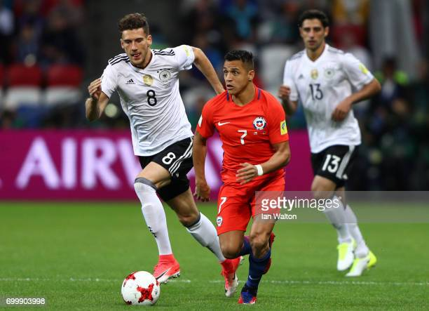 Alexis Sanchez of Chile takes the ball past Leon Goretzka of Germany during the FIFA Confederations Cup Russia 2017 Group B match between Germany and...