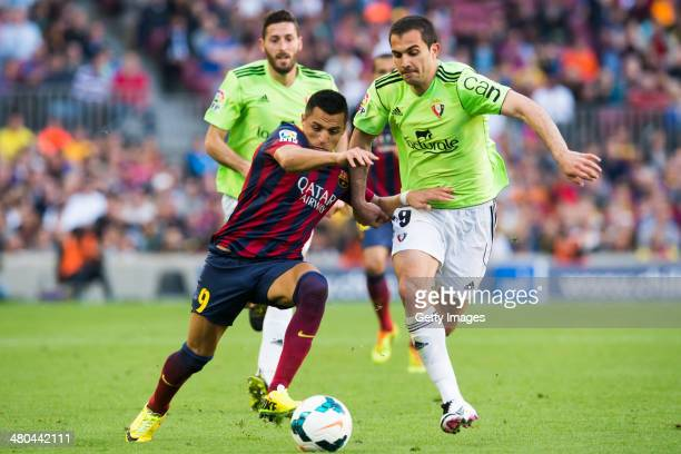 Alexis Sanchez of FC Barcelona and Emiliano Daniel Armenteros of CA Osasuna fight for the ball during the La Liga match between FC Barcelona and CA...