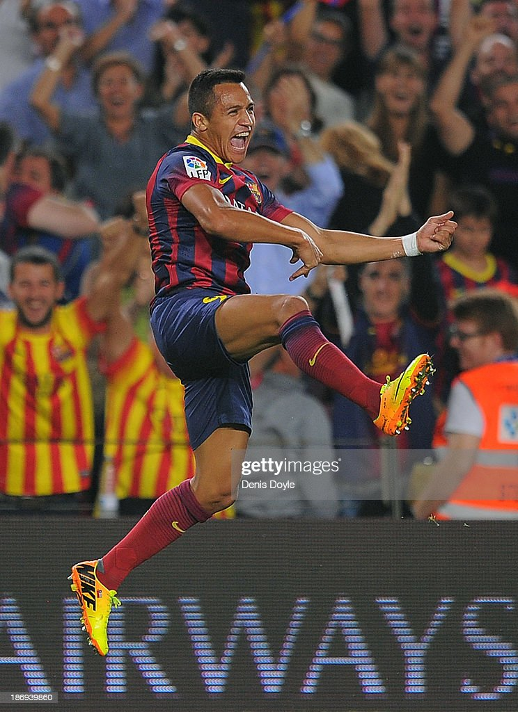 Alexis Sanchez of FC Barcelona celebrates after scoring his team's second goal during the La Liga match between FC Barcelona and Real Madrid CF at Camp Nou stadium on October 26, 2013 in Barcelona, Spain.