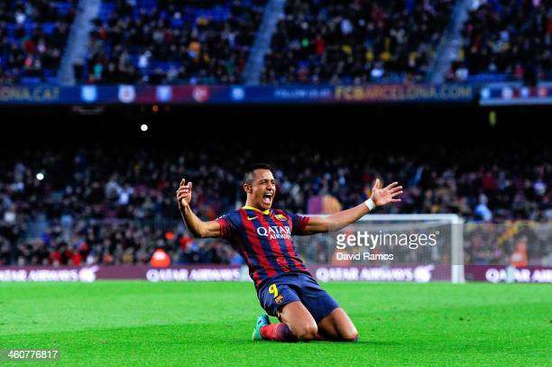 Alexis Sanchez of FC Barcelona celebrates after scoring his team's fourth goal to complete his hat-trick during the La Liga match between FC...