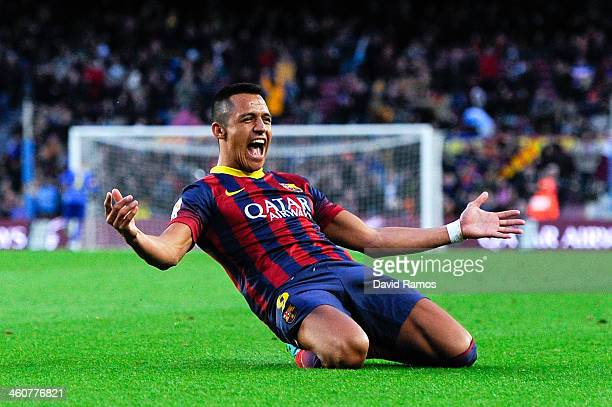 Alexis Sanchez of FC Barcelona celebrates after scoring his team's fourth goal to complete his hattrick during the La Liga match between FC Barcelona...