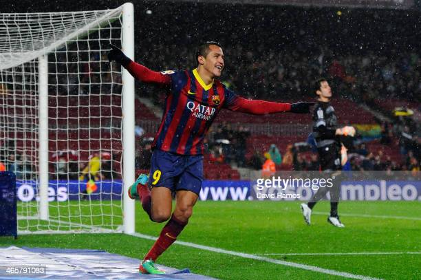 Alexis Sanchez of FC Barcelona celebrates after scoring his team's fourth goal during the Copa del Rey Quarter Final 2nd leg match between FC...