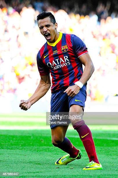 Alexis Sanchez of FC Barcelona celebrates after scoring his team's second goal during the La Liga match between FC Barcelona and Getafe CF at Nou...