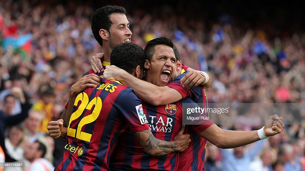 Alexis Sanchez of FC Barcelona celebrates after scoring the goal with his team mates Lionel Messi, Sergio Busquets and Dani Alves during the La Liga match between FC Barcelona and Atletico de Madrid at Camp Nou on May 17, 2014 in Barcelona, Spain.