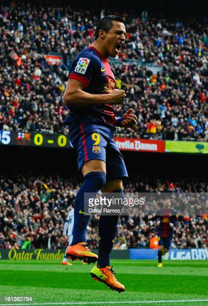 Alexis Sanchez of FC Barcelona celebrates after scoring the opening goal during the La Liga match between FC Barcelona and Getafe CF at Camp Nou on...