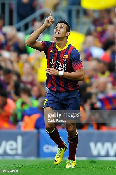 Alexis Sanchez of FC Barcelona celebrates after scoring the opening goal during the La Liga match between FC Barcelona and Club Atletico de Madrid at...