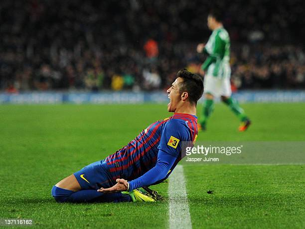 Alexis Sanchez of FC Barcelona celebrates on his knees after scoring his sides third goal during the la Liga match between FC Barcelona and Real...