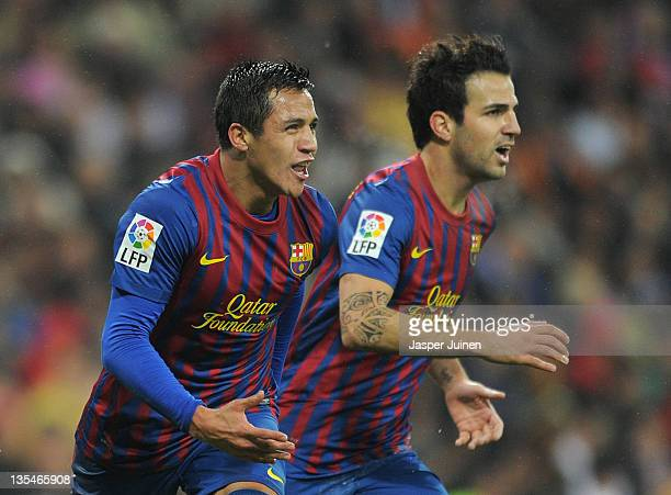 Alexis Sanchez of FC Barcelona celebrates scoring his sides equalizing goal beside his teammate Cesc Fabregas during the la Liga match between Real...