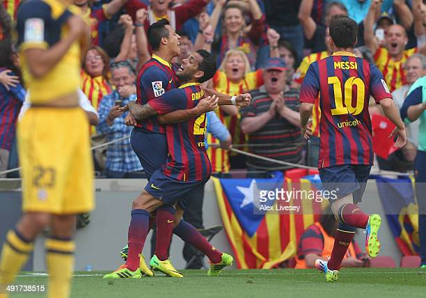 Alexis Sanchez of FC Barcelona celebrates with Dani Alves after scoring the opening goal during the La Liga match between FC Barcelona and Club...