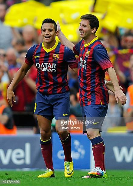 Alexis Sanchez of FC Barcelona celebrates with his teammate Lionel Messi of FC Barcelona after scoring the opening goal during the La Liga match...