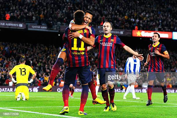 Alexis Sanchez of FC Barcelona celebrates with his teammate Neymar of FC Barcelona after scoring the opening goal during the La Liga match between FC...