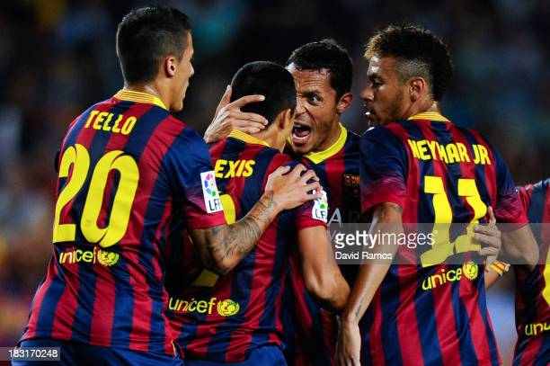 Alexis Sanchez of FC Barcelona celebrates with his teammates after scoring his team's first goal during the La Liga match between FC Barcelona and...