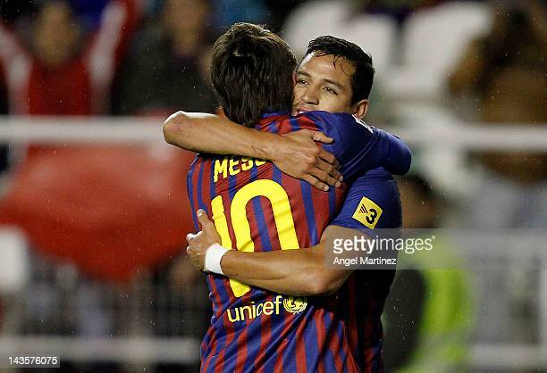 Alexis Sanchez of FC Barcelona celebrates with team mate Lionel Messi after scoring during the La Liga match between Rayo Vallecano and FC Barcelona...