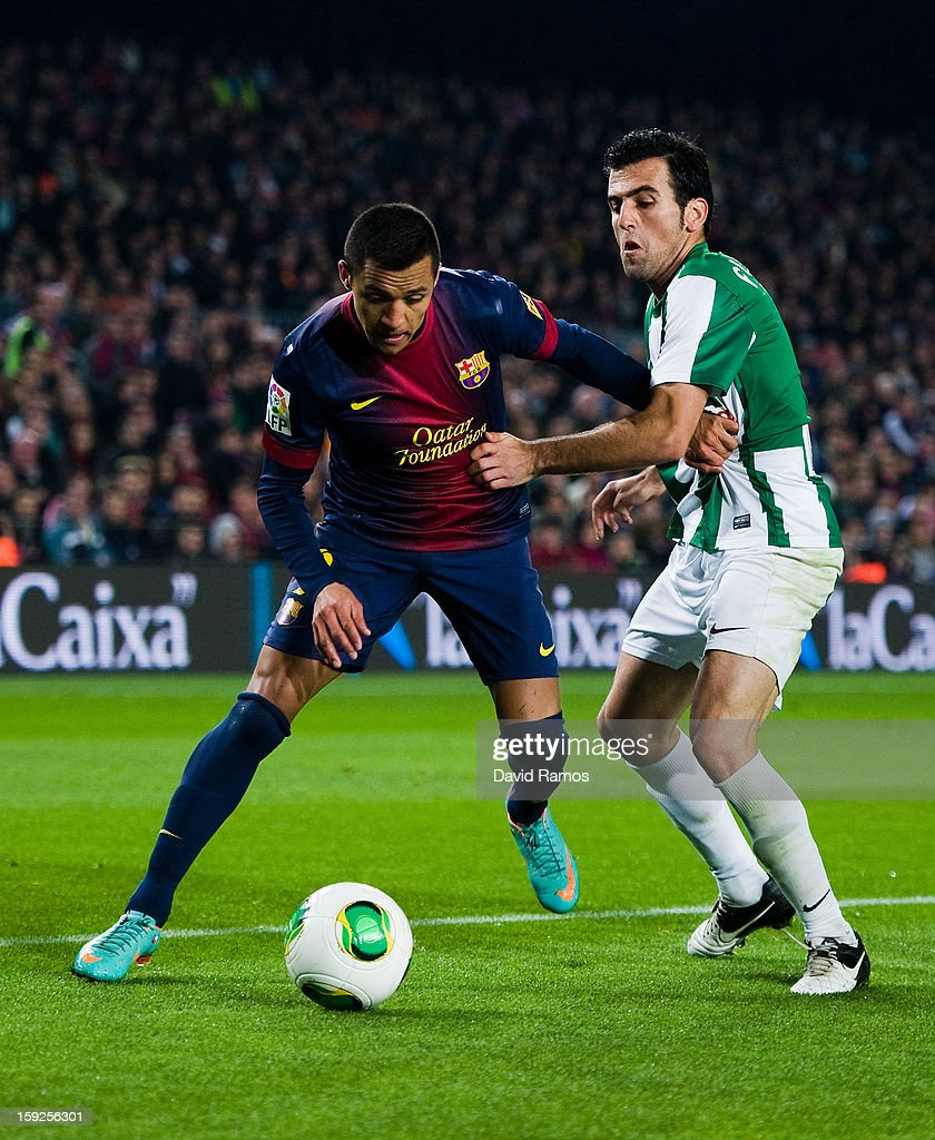 Alexis Sanchez of FC Barcelona (L) duels for the ball with Juan Rafael Fuentes of Cordoba CF during the Copa del Rey round of sixteen second leg match between FC Barcelona and Cordoba CF at Camp Nou on January 10, 2013 in Barcelona, Spain.