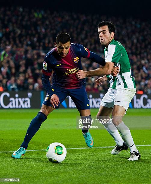Alexis Sanchez of FC Barcelona duels for the ball with Juan Rafael Fuentes of Cordoba CF during the Copa del Rey round of sixteen second leg match...