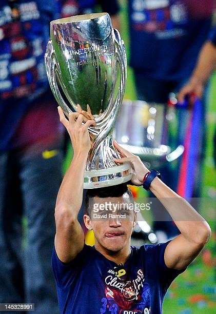 Alexis Sanchez of FC Barcelona holds up the UEFA Super cup Trophy during the FC Barcelona celebrations following the club's victory of the Copa del...