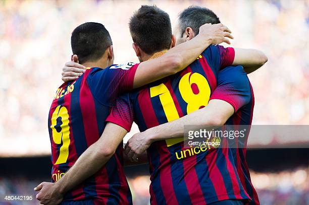 Alexis Sanchez of FC Barcelona is congratulated by his teammates Jordi Alba and Andres Iniesta after scoring his team's second goal during the La...