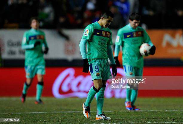 Alexis Sanchez of FC Barcelona looks down dejected after CA Osasuna scored the third goal during the La Liga match between CA Osasuna and FC...