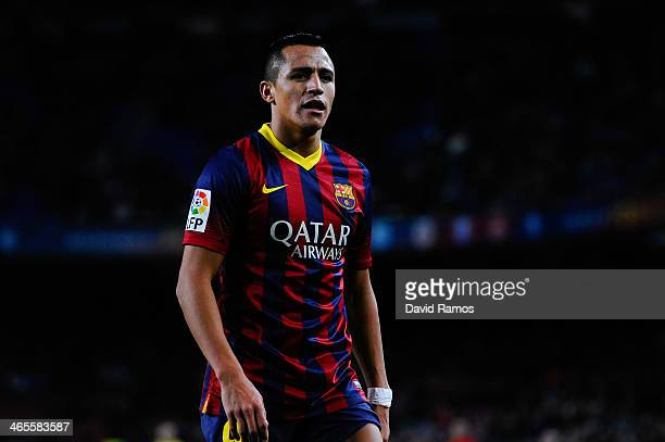 Alexis Sanchez of FC Barcelona looks on during the La Liga match between FC Barcelona and Malaga CF at Camp Nou on January 26 2014 in Barcelona Spain
