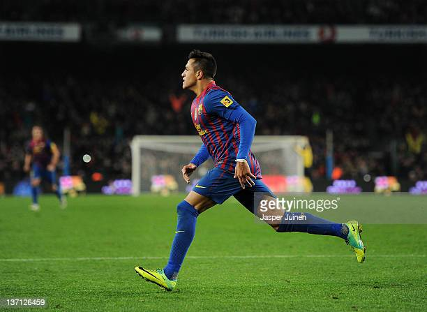 Alexis Sanchez of FC Barcelona runs in joy after scoring during the la Liga match between FC Barcelona and Real Betis Balompie at the Camp Nou...