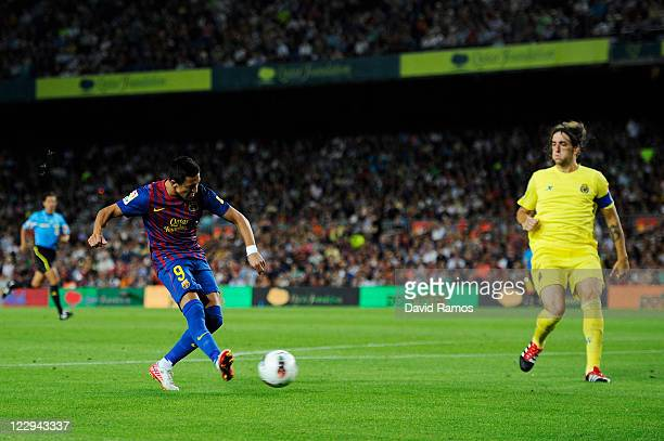 Alexis Sanchez of FC Barcelona scores his third team's goal during the La Liga match between FC Barcelona and Villarreal CF at Camp Nou on August 29...