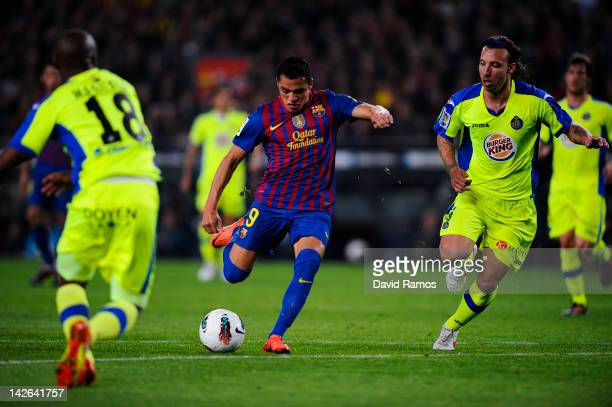 Alexis Sanchez of FC Barcelona scores the opening goal during the La Liga match between FC Barcelona and Getafe CF at Camp Nou on April 10 2012 in...