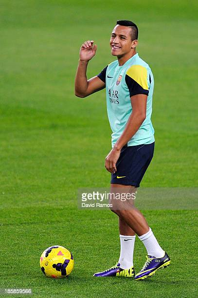 Alexis Sanchez of FC Barcelona smiles during a training session at the Camp Nou Stadium on October 25 2013 in Barcelona Spain
