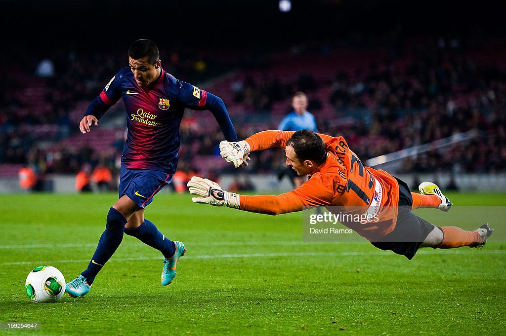 Alexis Sanchez of FC Barcelona (L) vies for the ball with Mikel Saizar of Cordoba CF during the Copa del Rey round of sixteen second leg match between FC Barcelona and Cordoba CF at Camp Nou on January 10, 2013 in Barcelona, Spain.
