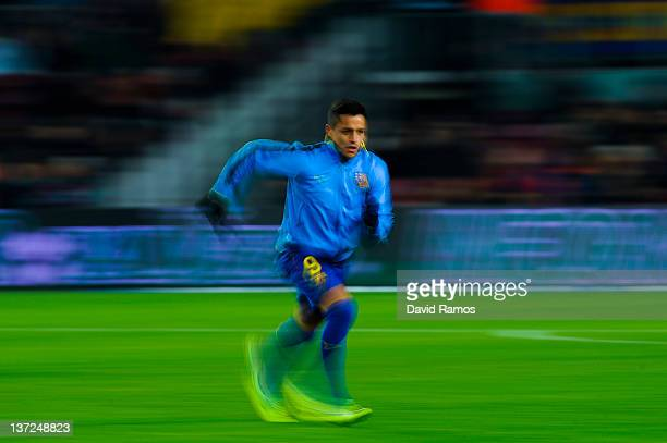 Alexis Sanchez of FC Barcelona warms up prior to the La Liga match between FC Barcelona and Real Betis Balompie at Camp Nou on January 15 2012 in...
