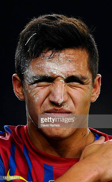 Alexis Sanchez of FC Barcelona with lime on his face leaves injured after being tackled by Pepe of Real Madrid during the Copa del Rey quarter final...