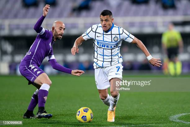 Alexis Sanchez of FC Internazionale and Borja Valero of ACF Fiorentina during the Serie A match between ACF Fiorentina and FC Internazionale at...