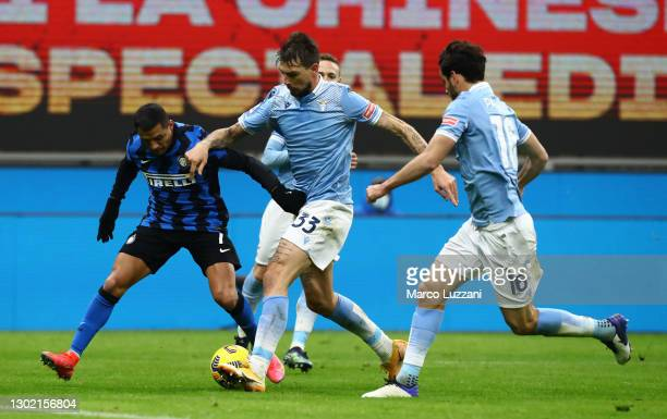 Alexis Sanchez of FC Internazionale and Francesco Acerbi of S.S. Lazio battle for possession during the Serie A match between FC Internazionale and...