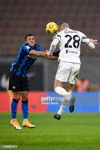 Alexis Sanchez of FC Internazionale and Merih Demiral of Juventus FC compete for a header during the Coppa Italia football match between FC...