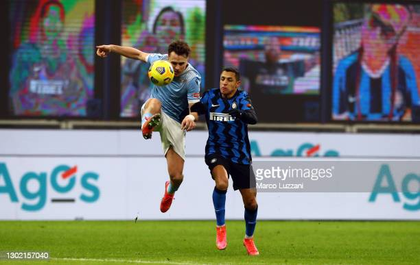 Alexis Sanchez of FC Internazionale and Patric of S.S. Lazio battle for possession during the Serie A match between FC Internazionale and SS Lazio at...