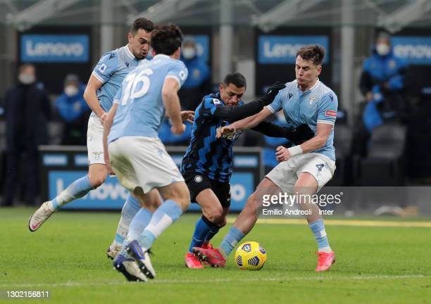 Alexis Sanchez of FC Internazionale battles for the possession with Gil Patric of SS Lazio during the Serie A match between FC Internazionale and SS...