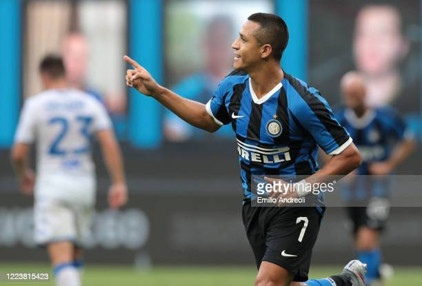 Alexis Sanchez of FC Internazionale celebrates after scoring the second goal of his team via penalty during the Serie A match between FC...