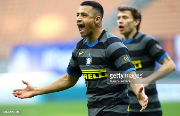 Alexis Sanchez of FC Internazionale celebrates after scoring their team's third goal during the Serie A match between FC Internazionale and Genoa CFC...