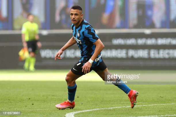 Alexis Sanchez of FC Internazionale celebrates after scoring their side's second goal during the Serie A match between FC Internazionale and UC...
