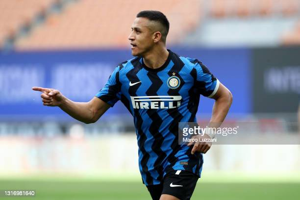 Alexis Sanchez of FC Internazionale celebrates after scoring their team's second goal during the Serie A match between FC Internazionale and UC...